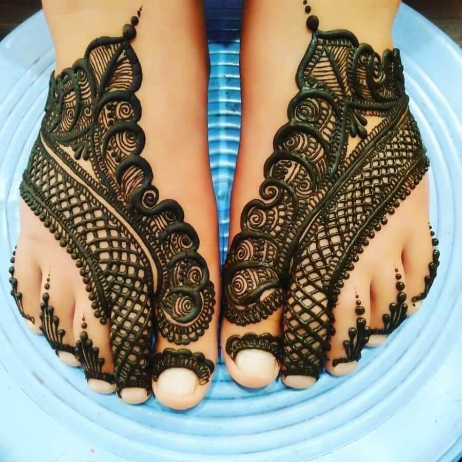 Bold henna foot design