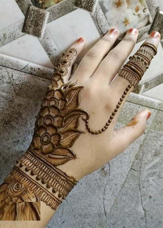 level back hand mehndi design bridal